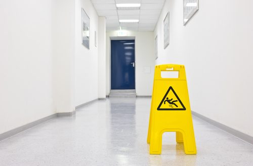 wet floor sign in hallway