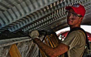grimy steel worker