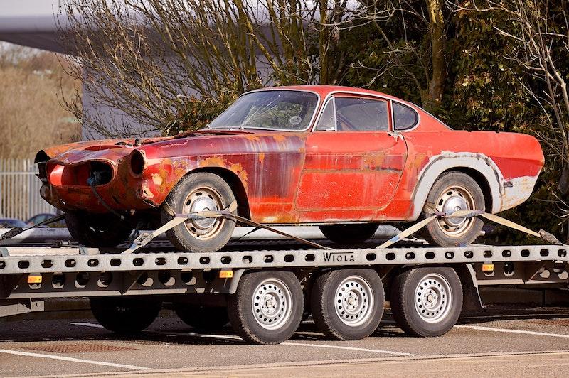 antique car on flatbed trailer